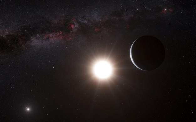 An artist's illustration of an exoplanet orbiting one star of a binary system.